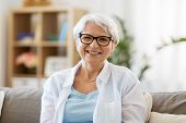 vision, age and people concept - portrait of happy senior woman in glasses poster