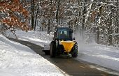 picture of cleaning service  - snow plowing machine cleaning the bike trail during winter time - JPG