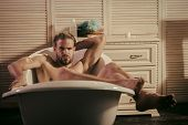 Rest After Work. Macho Relax Naked In Bathtub In Bathroom. Macho With Muscular Legs, Chest, Arms, Bi poster