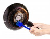 The Frying Pan Scorching Fat Cleaning Brush In A Hand On A White Background Isolation poster