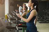 People Run On Treadmills. Men And Women Cardio Workout In Fitness Club. Healthy Lifestyle, Training  poster
