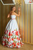 Portrait of attractive blonde woman in formal dress poster