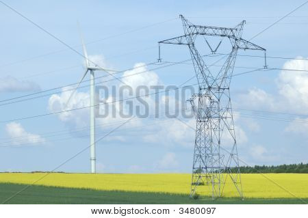 A Electric Pylon Near Windturbine