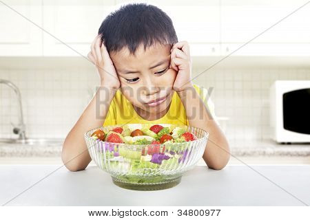 Unhappy Child To Eat Salad