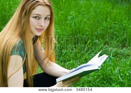 Beautiful Girl Reading In Park