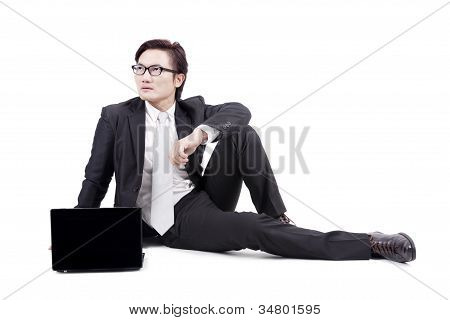 Businessman With Laptop On White