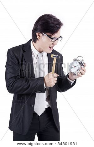 Angry Businessman Hitting Alarm Clock