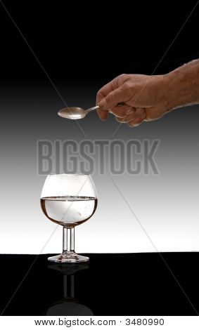 Glass On Table With Graduated Background