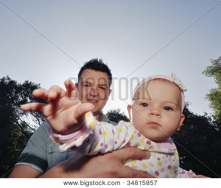 Young Happy Father And Daughter