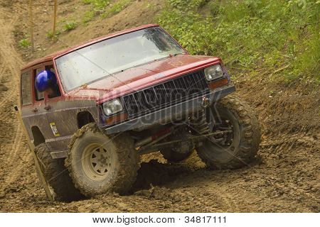 Red Off-road Car In Terrain.