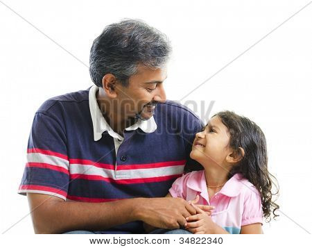 Asian Indian father having conversation with her daughter over white background