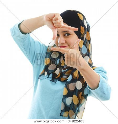 Smiling Asian Muslim woman making a frame with fingers