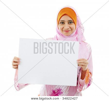 Beautiful Young Muslim girl holding a white card board over white background