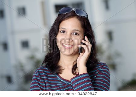 Indian Girl Talking On The Cellphone