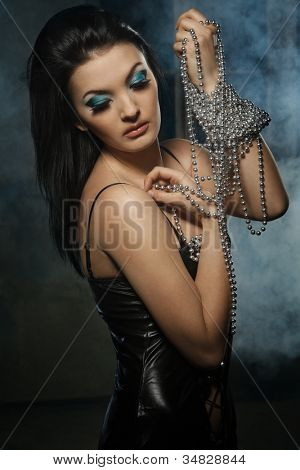 Portrait of young stylish woman with silver beads
