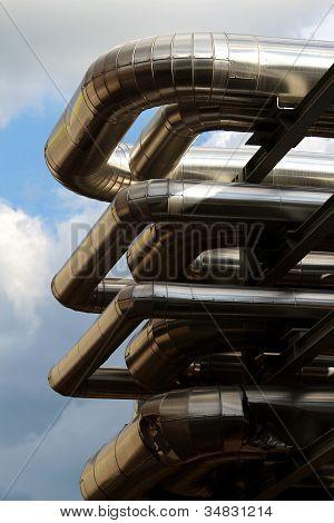 Metal Oil Pipe In Refinery Under Sky