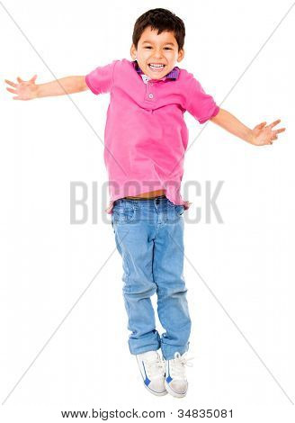 Happy boy jumping - isolated over a white background
