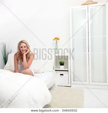 Girl In A White Bedroom