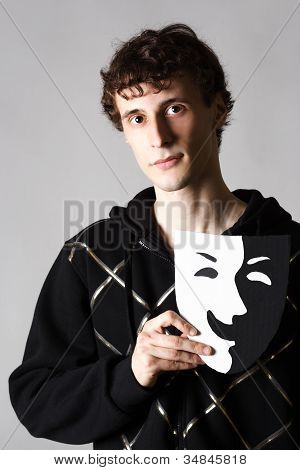 Portrait Of Young Man Holding Black And White Theater Laughing Mask, Contrast Shadows