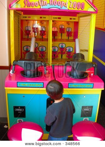Child Playing Arcade Game