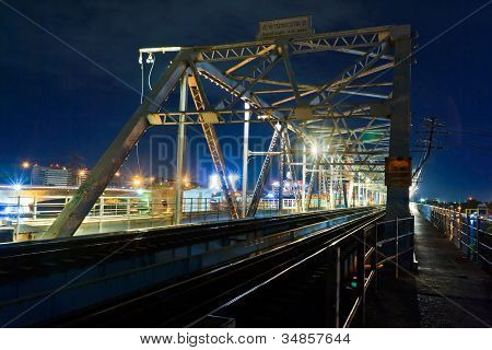 Old Iron Railway Bridge For The Passage Of Trains, At Night.