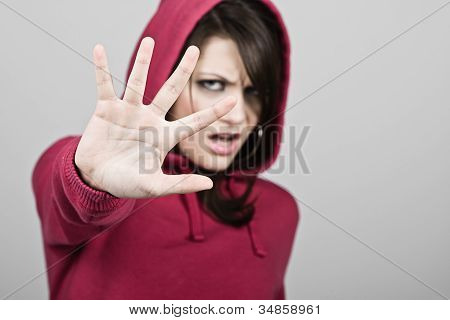 Hooded Teenage Girl Holding Hand Up