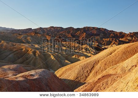 The famous section of Death Valley in California - Zabriskie Point. Magically beautiful sunset