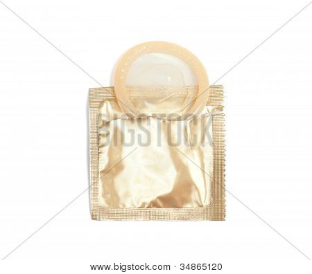 Open Pack Of Condom Isolated On White