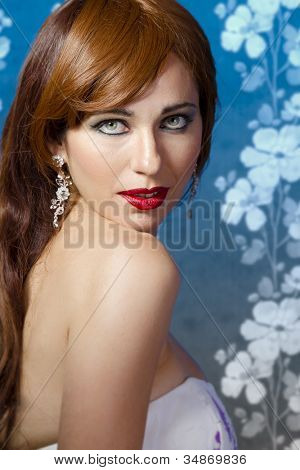 Beautiful redhead on blue vintage background
