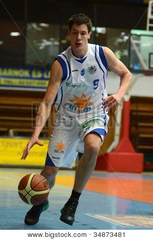 KAPOSVAR, HUNGARY - FEBRUARY 22: Unidentified player in action at a Hungarian Cup basketball game with Kaposvar (white) vs. Fehervar (blue) on February 22, 2012 in Kaposvar, Hungary.