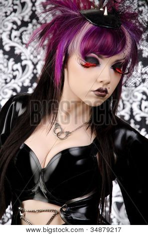 She Devil - Sexy Dark Fashion Vixen in Latex with Vintage Background