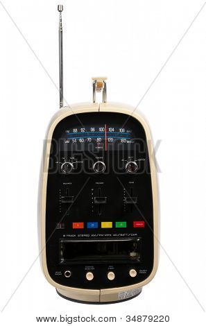 Retro portable eight track tape player & radio isolated on black background
