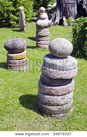 Stone And Millstone Collection In The Yard