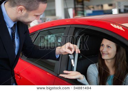 Customer receiving car keys in a dealership