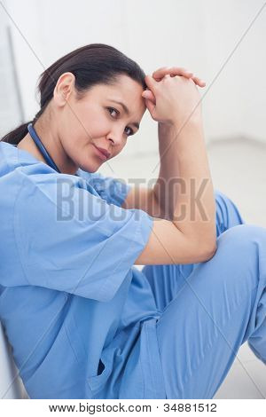 Nurse sitting on the floor in hospital ward