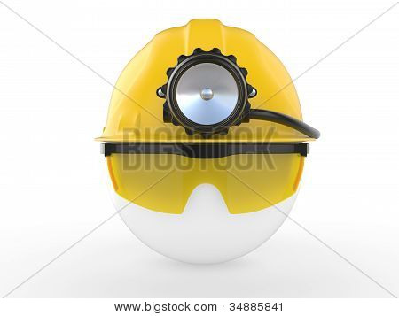 Worker with helmet and head lamp