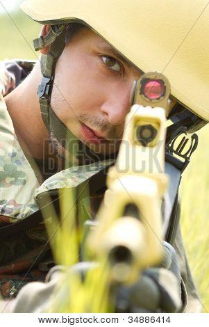 Portrait Of Soldier In Helmet Targeting