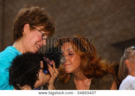 Judy McClane (rt.) of Momma Mia Reciprocates a Nuzzling