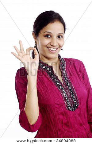 Smiling Young Woman With Ok Sign