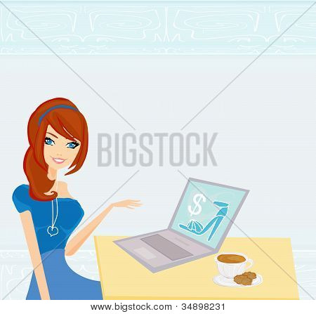 Online shopping - young smiling woman with laptop computer
