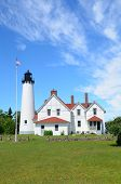 image of iroquois  - Point Iroquois Lighthouse on Lake Superior in Summer - JPG
