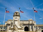stock photo of amtrak  - Union Station at Washington DC with Three American Flags - JPG