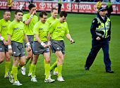MELBOURNE - JUNE 30 : Umpires leave the ground after Collingwood's win over Fremantle on June 30, 20