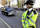 LONDON, UK - MARCH 12: A police woman outside Westminster Abbey where Queen Elizabeth II attends the