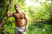picture of cenote  - Attractive man enjoying nature - JPG