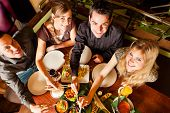 picture of chopsticks  - Young people eating in a Thai restaurant - JPG