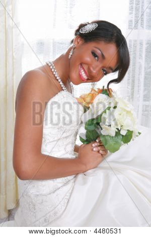 Beautiful Young Bride Sitting By The Window