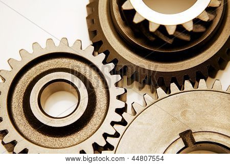 Closeup of three metal cog gears