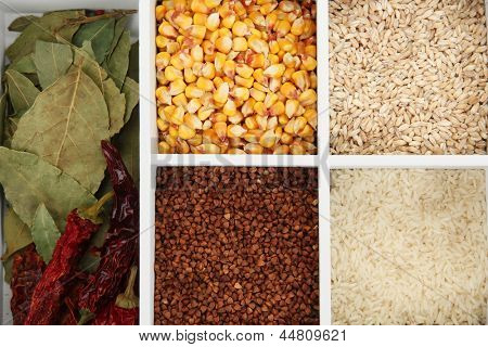 Assortment of cereals in white wooden box close up