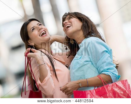 Happy women in a shopping spree carrying bags